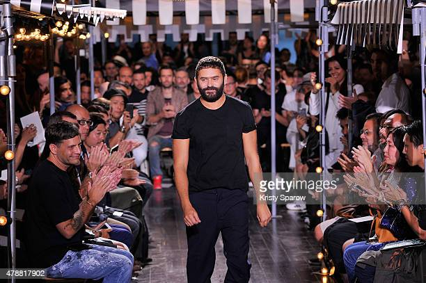 Alexandre Mattiussi acknowledges the audience during the AMI Alexandre Mattiussi Menswear Spring/Summer 2016 show as part of Paris Fashion Week on...