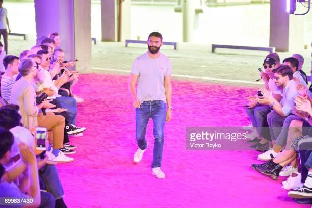 Alexandre Mattiussi walks the runway during the Ami Alexandre Mattiussi Menswear Spring/Summer 2018 show as part of Paris Fashion Week on June 22...