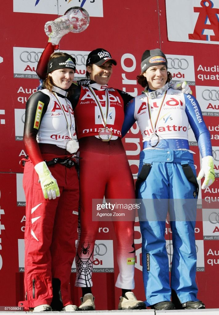 Alexandre Meissnitzer, Michaela Dorfmeister and Nadia Styger pose on the podium for the Overall FIS Skiing World Cup Super-G on March 16, 2006 in Aare, Sweden