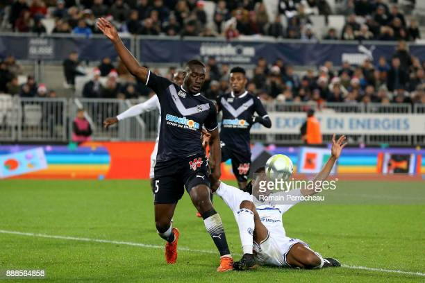 Alexandre Mendy of Bordeaux and Bakary Kone of Strasbourg in action during the Ligue 1 match between FC Girondins de Bordeaux and Strasbourg at Stade...