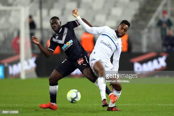 Alexandre Mendy of Bordeaux and Yoann Salmier of Strasbourg during the Ligue 1 match between FC Girondins de Bordeaux and Strasbourg at Stade Matmut...
