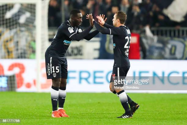 Alexandre Mendy of Bordeaux celebrates with Valentin Vada after scoring a goal during the Ligue 1 match between FC Girondins de Bordeaux and AS...