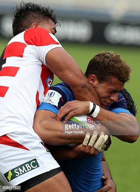 Alexandre Nicoue of France tackled by Ataata Moeakiola of Japan during the World Rugby U20 Championship match between France and Japan at AJ Bell...