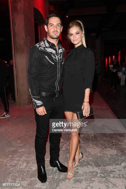 Alexandre Pato and Danielle Knudson attend Dsquared2 show during Milan Men's Fashion Spring/Summer 2019 on June 17 2018 in Milan Italy
