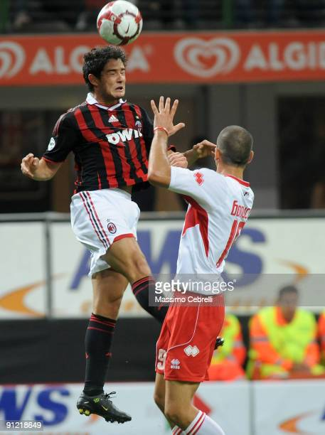Alexandre Pato of AC Milan and Leonardo Bonucci of AS Bari compete for the ball during the Serie A match between AC Milan and AS Bari at Stadio...