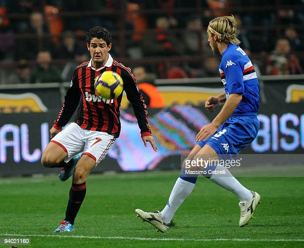 Alexandre Pato of AC Milan battles for the ball against Reto Ziegler of UC Sampdoria during the Serie A match between AC Milan and UC Sampdoria at...