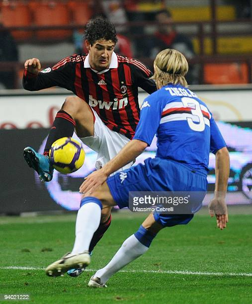 Alexandre Pato of AC Milan competes for the ball with Reto Ziegler of UC Sampdoria during the Serie A match between AC Milan and UC Sampdoria at...