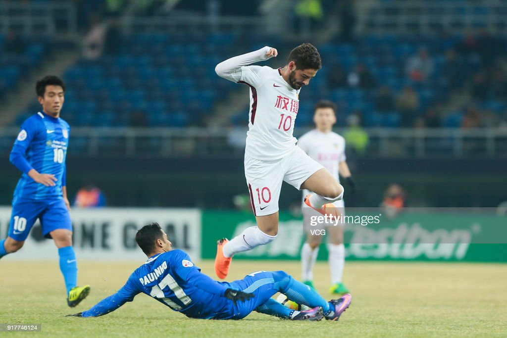 Alexandre Pato #10 of Tianjin Quanjian and Paulinho #17 of Kitchee vie for the ball during the 2018 AFC Champions League Group E match between Tianjin Quanjian FC and Kitchee SC at Tianjin Olympic Center Stadium on February 13, 2018 in Tianjin, China.