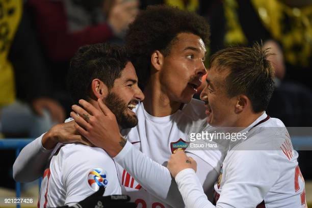 Alexandre Pato of Tianjin Quanjian celebrates scoring his side's first goal to make it 11 with his team mates Axel Witsel and Wang Yongpo during the...