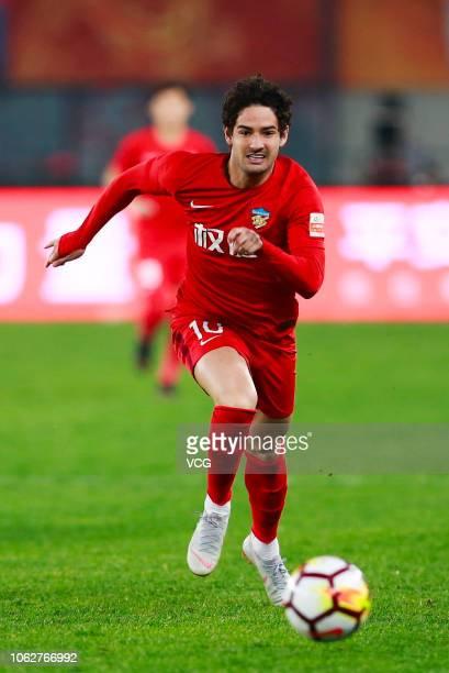 Alexandre Pato of Tianjin Quanjian drives the ball during the 2018 Chinese Super League 28th round match between Tianjin Quanjian and Henan Jianye at...