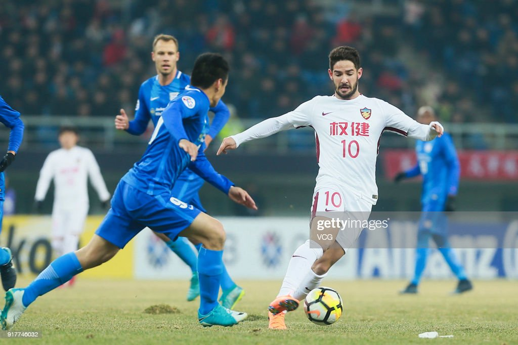 Alexandre Pato #10 of Tianjin Quanjian vies for the ball during the 2018 AFC Champions League Group E match between Tianjin Quanjian FC and Kitchee SC at Tianjin Olympic Center Stadium on February 13, 2018 in Tianjin, China.