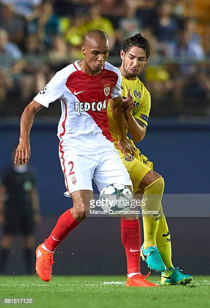 Alexandre Pato of Villarreal competes for the ball with Fabinho of Monaco during the UEFA Champions League play-off first leg match between...