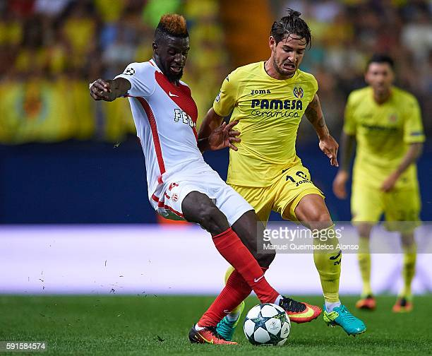 Alexandre Pato of Villarreal competes for the ball with Tiemoue Bakayoko of Monaco during the UEFA Champions League playoff first leg match between...