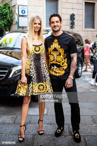 Alexandre Pato wearing Versace t shirt and Danielle Knudson wearing Versace dress are seen in the streets of Milan before the Versace show during...