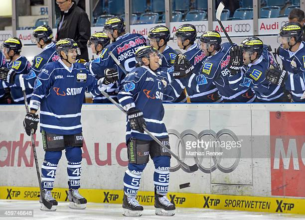 Alexandre Picard and Patrick Koeppchen of ERC Ingolstadt celebrate with the substitutes' bench during the game between ERC Ingolstadt and Eisbaeren...