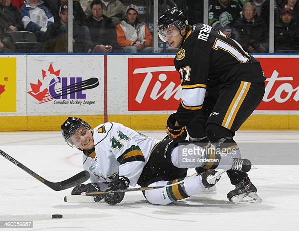 Alexandre Renaud of the Sarnia Sting knocks Dakota Mermis ofthe London Knights to the ice during an OHL game at Budweiser Gardens on December 31 2013...
