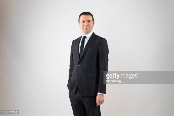 Alexandre Ricard chief executive officer of Pernod Ricard SA poses for a photograph following a Bloomberg Television interview in London UK on...