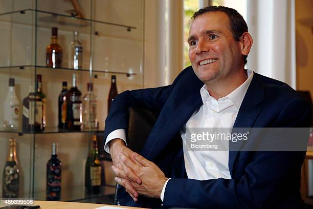 Alexandre Ricard chief executive officer of Pernod Ricard SA smiles during an interview at the company's headquarters in Paris France on Thursday Aug...