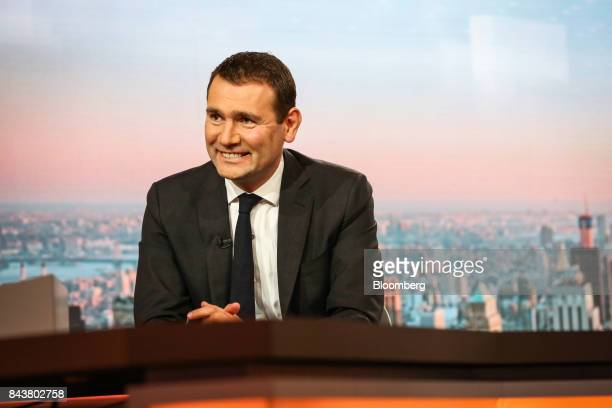 Alexandre Ricard chief executive officer of Pernod Ricard SA smiles during a Bloomberg Television interview in New York US on Thursday Sept 7 2017...