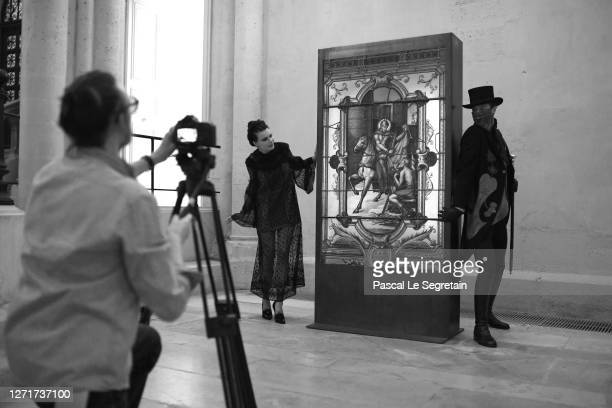 Alexandre Risso, Il Medico character and Jeade Pasquier, La commedia character pose in front of Stained glass window in lead, glass, enamel, iron and...