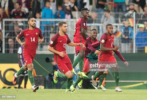Alexandre SIlva of Portugal celebrates his team's third goal with team mates during the UEFA Under19 European Championship match between U19 Germany...