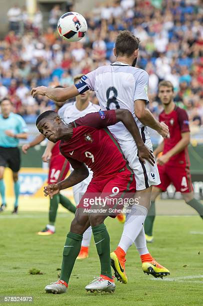 Alexandre Silva of Portugal challenges Lucas Tousart of France during the U19 match between Portugal and France at CarlBenzStadium on July 21 2016 in...