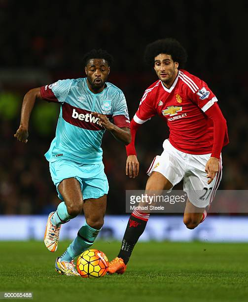 Alexandre Song of West Ham United and Marouane Fellaini of Manchester United compete for the ball during the Barclays Premier League match between...