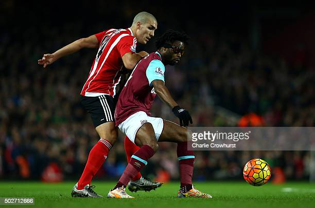 Alexandre Song of West Ham United holds off Oriol Romeu of Southampton during the Barclays Premier League match between West Ham United and...