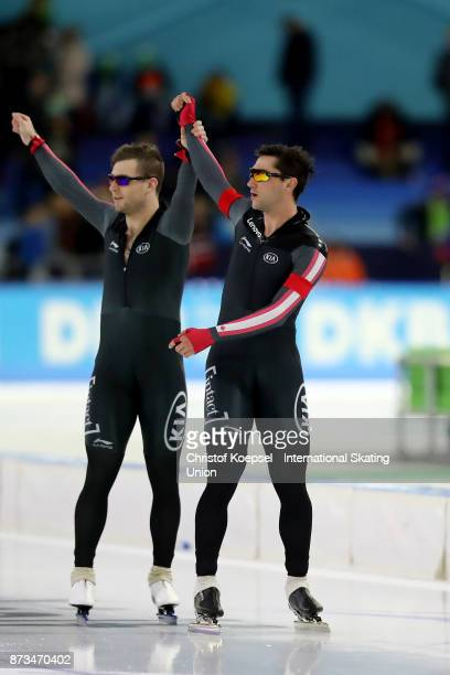 Alexandre StJean and Vincent de Haitre of Canada celebrate winning the men team sprint on Day Three during the ISU World Cup Speed Skating at the...