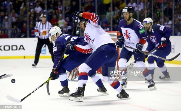 Alexandre Texier of France challenges David Phillips of Great Britain during the 2019 IIHF Ice Hockey World Championship Slovakia group A game...