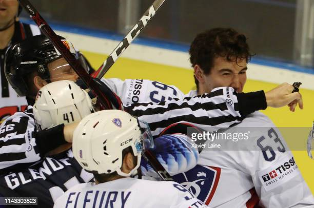 Alexandre Texier of France fights with Luke Glendening of USA during the 2019 IIHF Ice Hockey World Championship Slovakia group A game between United...