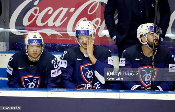 Alexandre Texier of France reacts with teammates after being defeated in the 2019 IIHF Ice Hockey World Championship Slovakia group A game between...