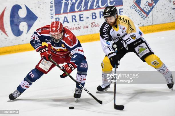 Alexandre Texier of Grenoble François Pierre Guenette of Rouen during the semi Final of the Ligue Magnus match between Grenoble and Rouen on March...