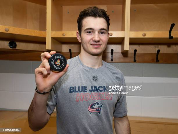 Alexandre Texier of the Columbus Blue Jackets poses with the puck with which he scored his first career NHL goal, after a game against the Ottawa...