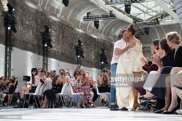 Alexandre Vauthier kisses Celine Dion after the Alexandre Vauthier Haute Couture Fall/Winter 2019 2020 show as part of Paris Fashion Week on July 02...