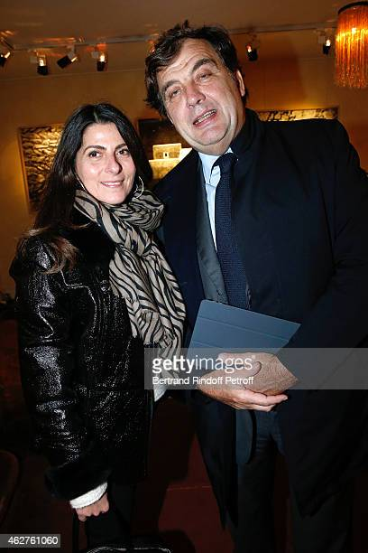 Alexandre Vilgrain and his wife Denise attend the Patrice Calmettes Exhibition at Galerie Passebon on February 4 2015 in Paris France