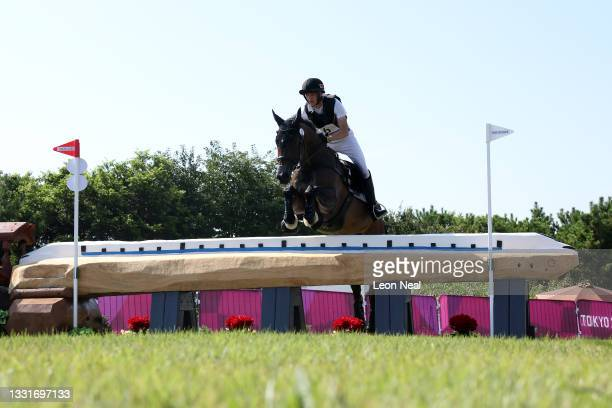 Alexandre Zelenko of Team Belarus riding Carlo Grande Jr. Clears a jump during the Eventing Cross Country Team and Individual on day nine of the...