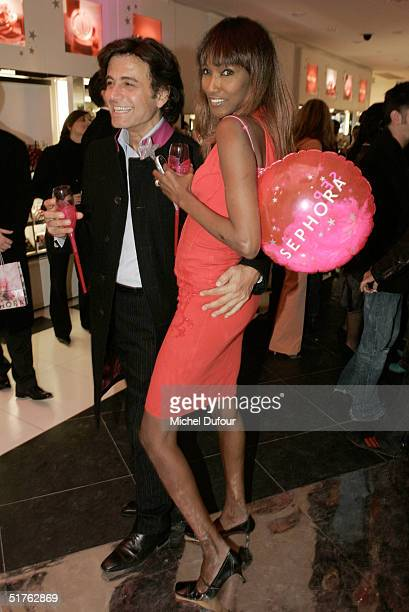 Alexandre Zouari and Katoucha attend the new Sephora store opening party on Haussmann Boulevard November 18 2004 in Paris France
