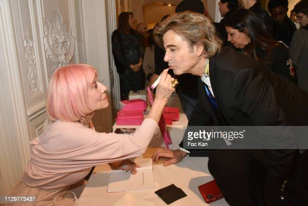 Alexandre Zouari and Marie Beltrami attend 'Le Monde de Marie Beltrami' Exhibition Preview at Art Curial on February 14 2019 in Paris France