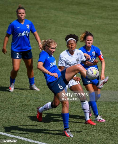 Alexandrea Long Batista of OL Reign fights for the ball with Celeste Boureille of Portland Thorns FC during a game on day 8 of the NWSL Challenge Cup...