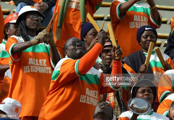 Ivorian supporters perform for their team before their semi-final African Nations Cup football game against Nigeria in Alexandria, Egypt 07 February...