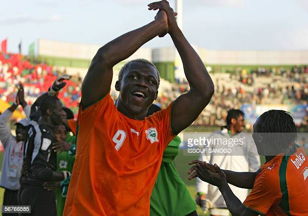 Ivory Coast's Arouna Kone and Arthur Boka celebrate his team's victory over Nigeria in their semifinal African Nations Cup football game in...