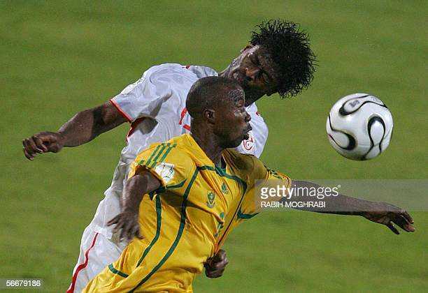 Siyabonga Nomvethe of South Africa fights for the ball with Tunisia's Radhi Jaidi during their Group C African Nations Cup football match in...