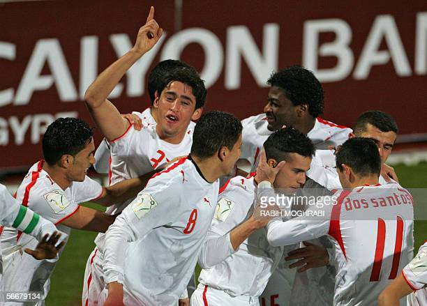 Tunisian players celebrate after Selim Ben Achour scored the second goal against South Africa during their Group C African Nations Cup football match...