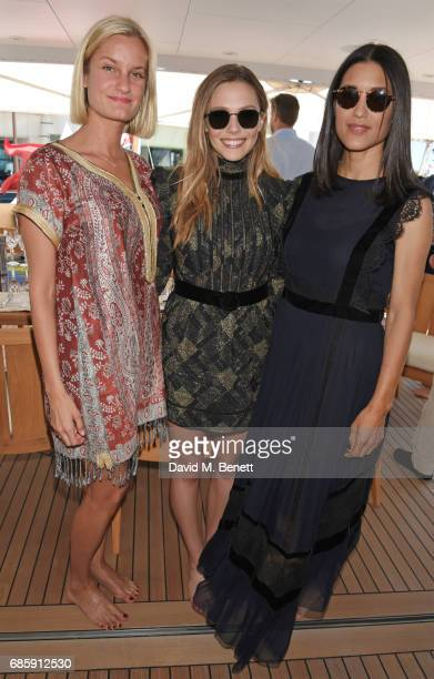 Alexandria Jackson Elizabeth Olsen and Julia Jones attend a lunch hosted by Lexus for The Weinstein Company's Wind River stars and director on May 20...