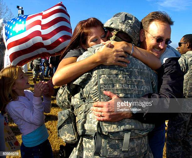 Alexandria McBroom, left, hugs her husband U.S. Army PFC Dustin McBroom during a homecoming ceremony for 200 soldiers with the Army's 3rd Infantry...