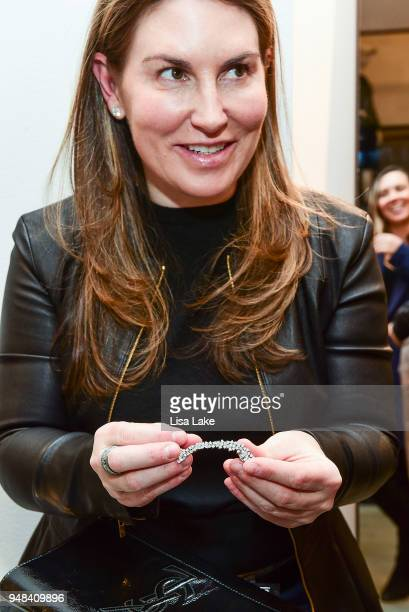 Alexandria Murphy holds a jewelry piece designed by Ana Khouri during Barneys New York Foundation Celebrates UNICEF USA at Barneys New York In...