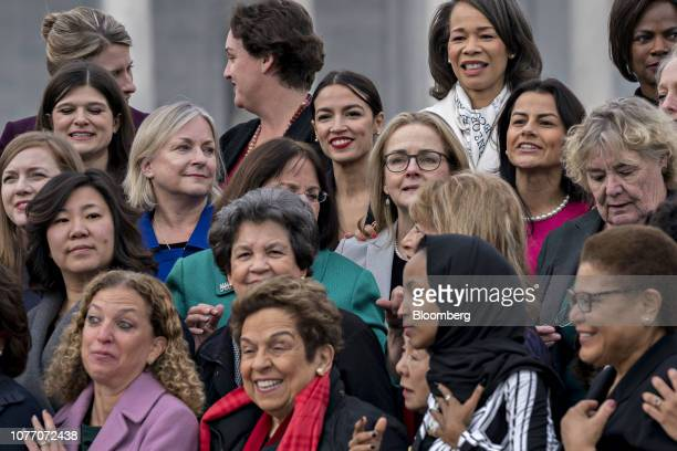 Alexandria OcasioCortez a Democrat from New York top center stands for a photograph with House Democratic women members of the 116th Congress in...