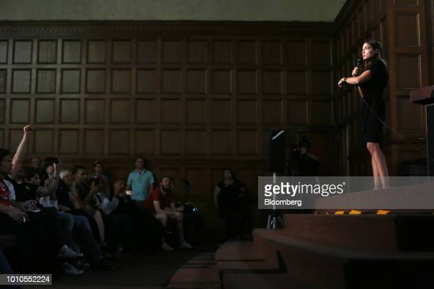 Alexandria OcasioCortez a Democratic US Representative candidate from New York right speaks during an event at the First Unitarian Church of Los...