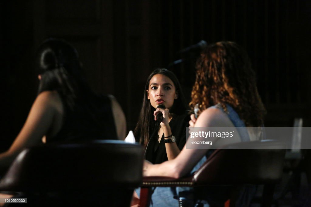 Alexandria Ocasio-Cortez, a Democratic U.S. Representative candidate from New York, center, speaks during an event at the First Unitarian Church of Los Angeles in Los Angeles, California, U.S., on Friday, Aug. 3, 2018. Ocasio-Cortez campaigned on abolishing ICE en route to her stunning upset primary victory in a New York City district against a top House Democrat. Photographer: Dania Maxwell/Bloomberg via Getty Images
